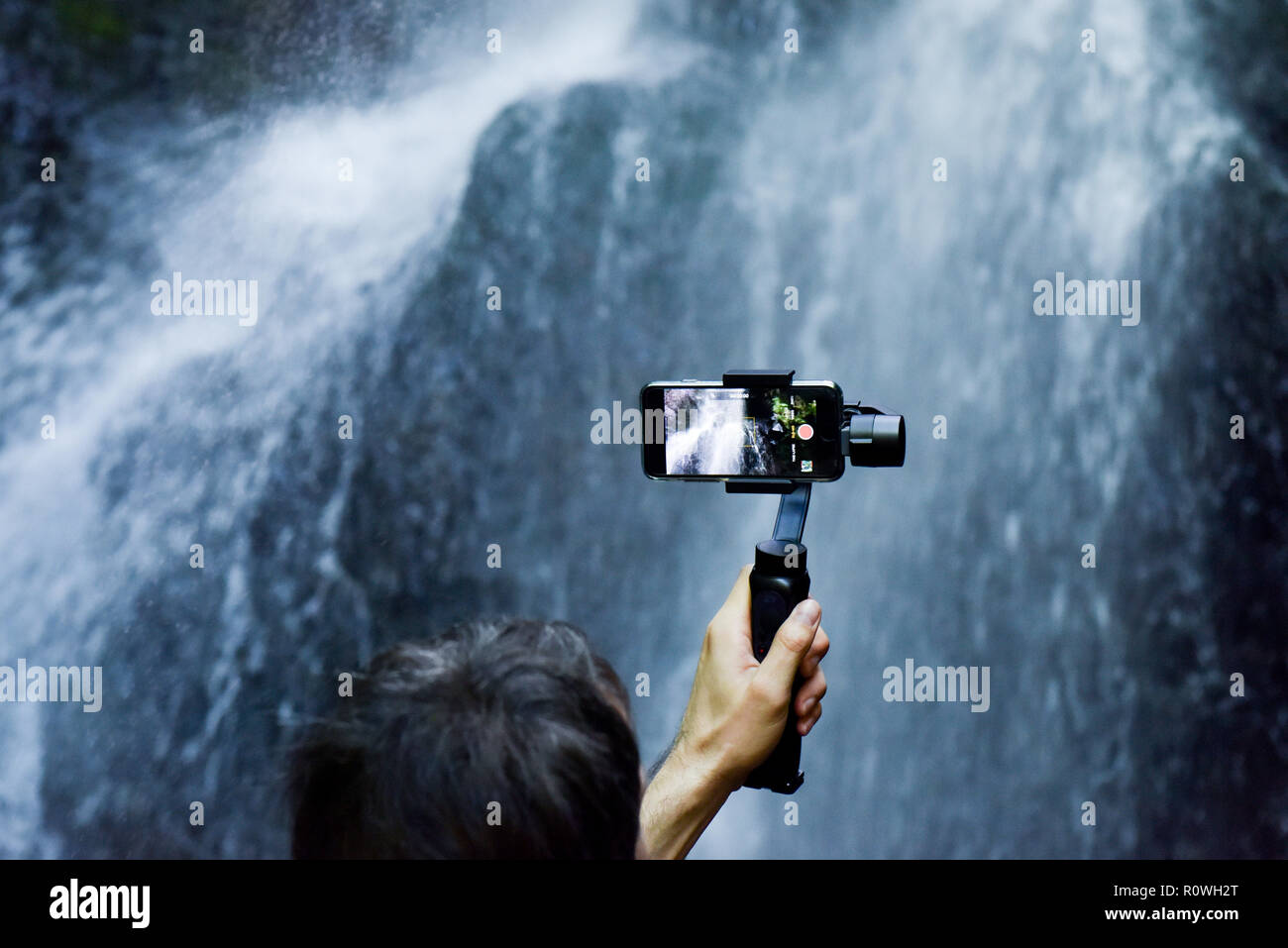 Person taking video with an Iphone Stock Photo