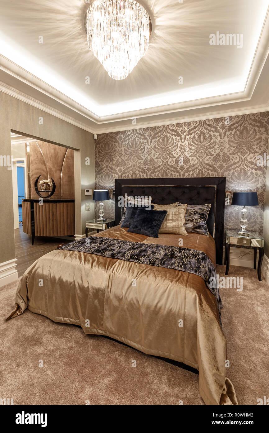 Master bedroom interior in brown tones - Stock Image