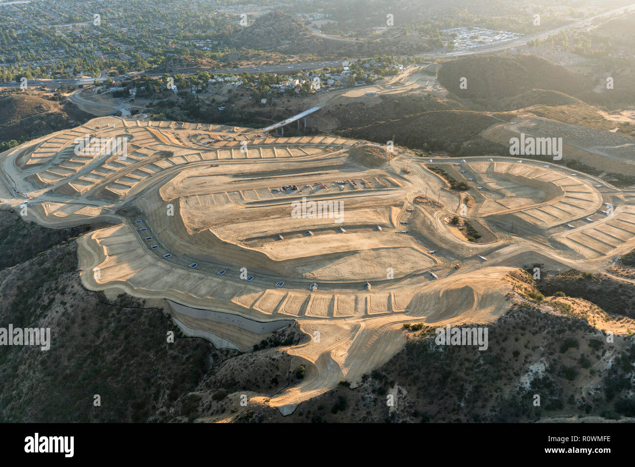 Aerial view of hilltop construction grading above the San Fernando Valley in Los Angeles, California. - Stock Image