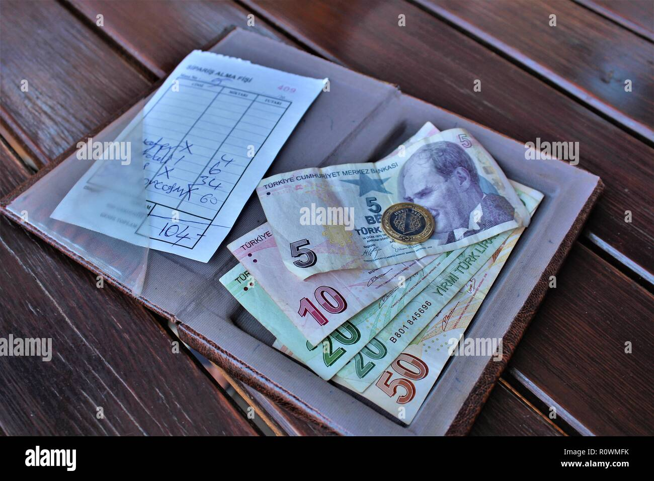 Dalyan, Turkey - July 7th 2018: Turkish Lira currency being used to pay a restaurant bill. Stock Photo