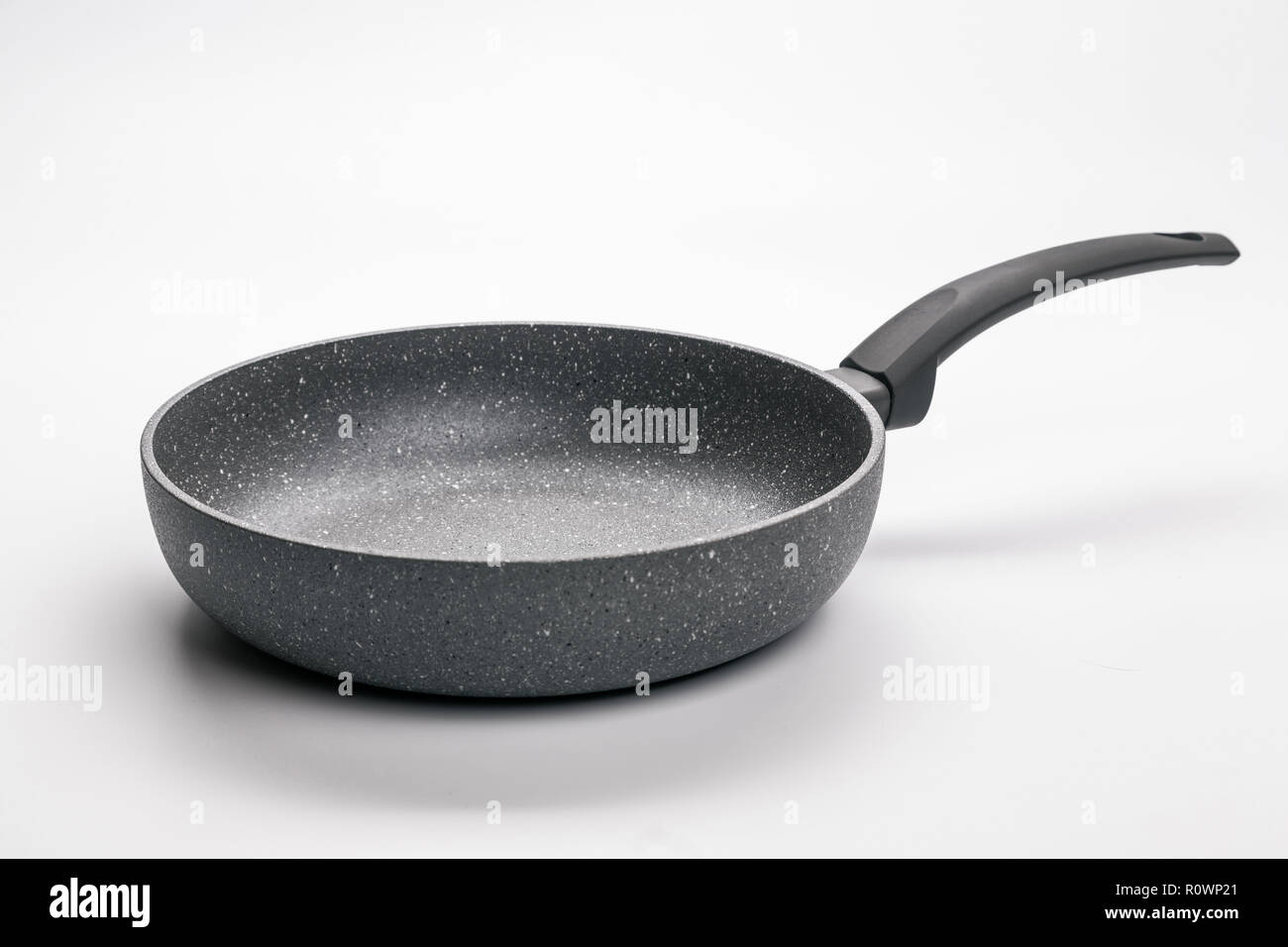Stone Frying Pan Isolated on White Background. Angle View. Stock Photo