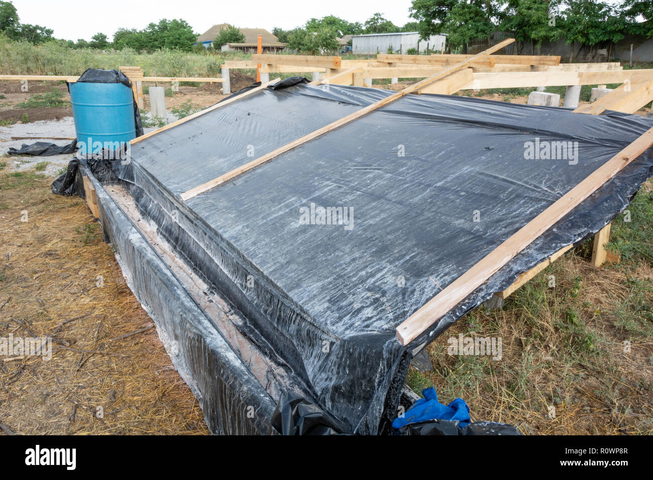 A box-platform for the impregnation of pine boards with an antiseptic protective agent against insects and fire. Construction of the frame house. Stock Photo