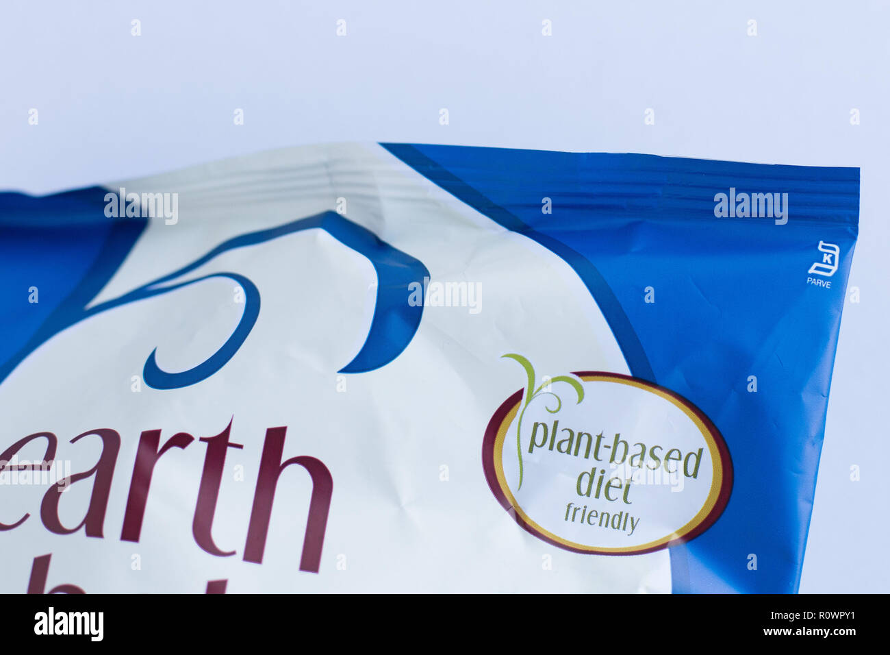 "Close up of bag of Earth Balance vegan cheese puffs, emphasizing ""plant-based diet"" on label. Stock Photo"