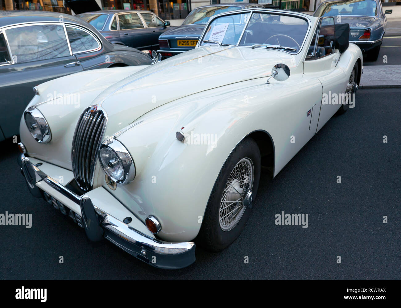 Three-quarter front view of a  1954, white, Jaguar XK 140  on display at the Regents Street Motor Show, 2018 Stock Photo