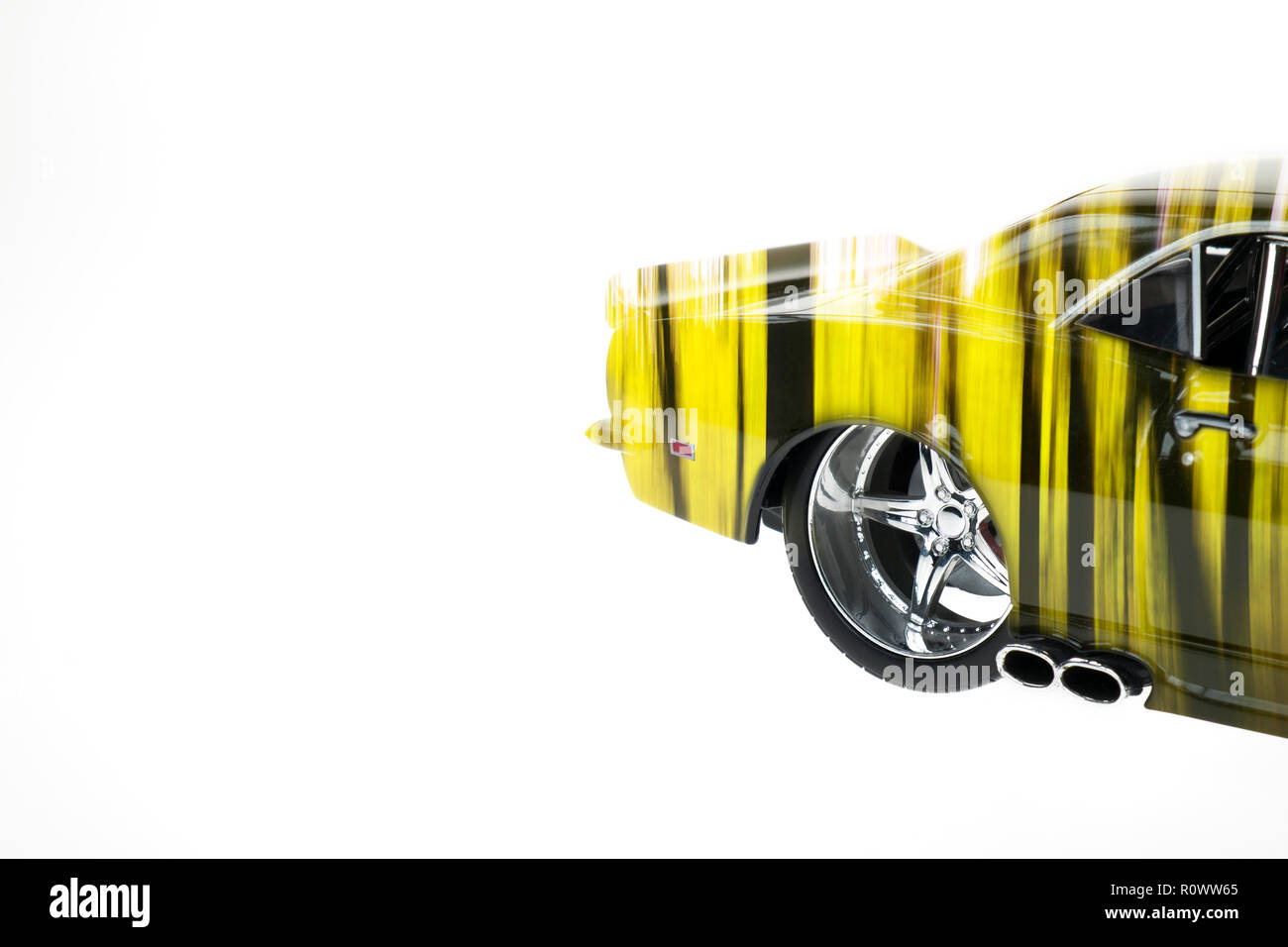 Rear view of a muscle diecast car double exposured with autumn forest image on isolated white background Stock Photo