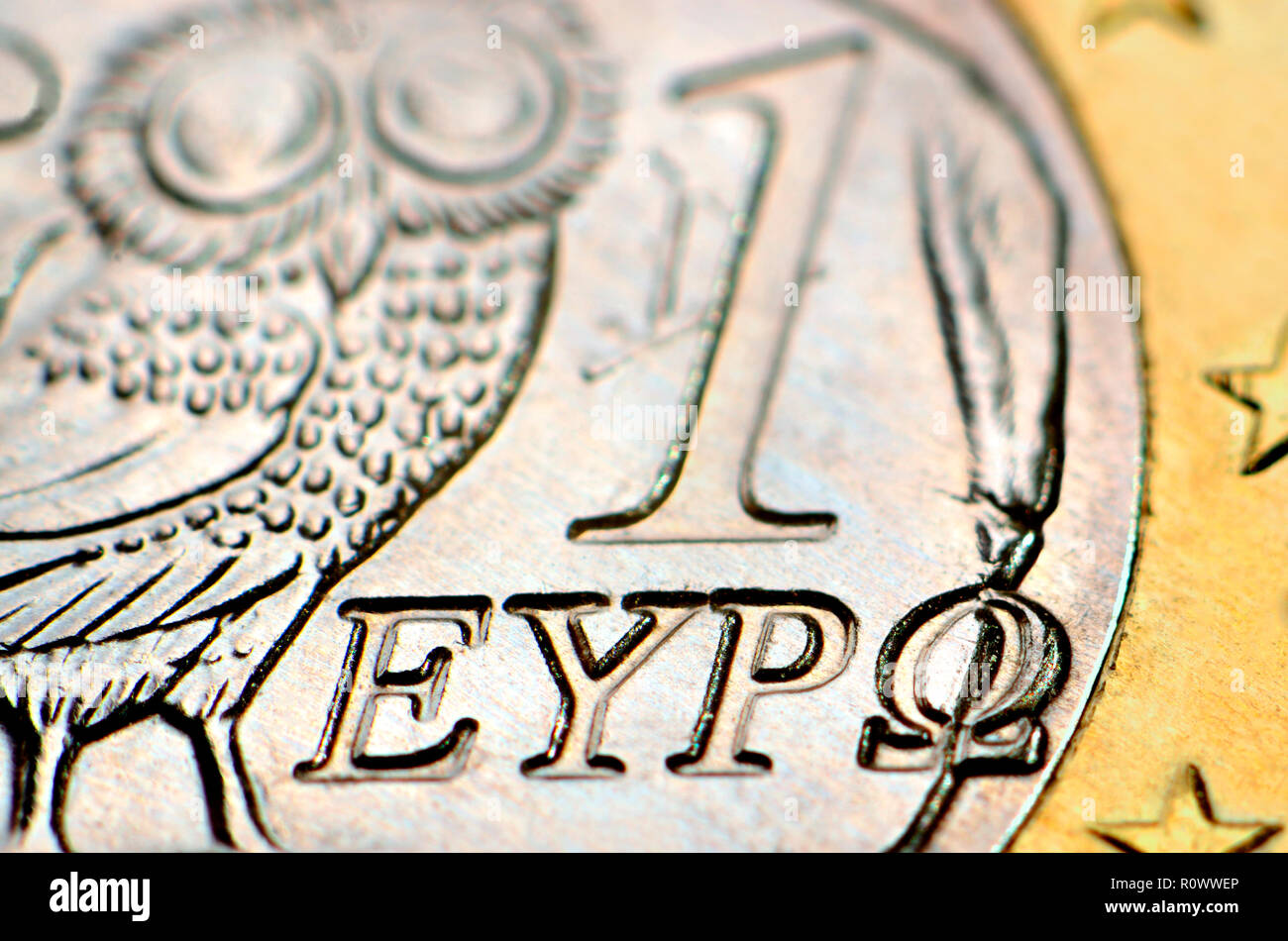 Greek 1 Euro coin on a 10 Euro note - Stock Image