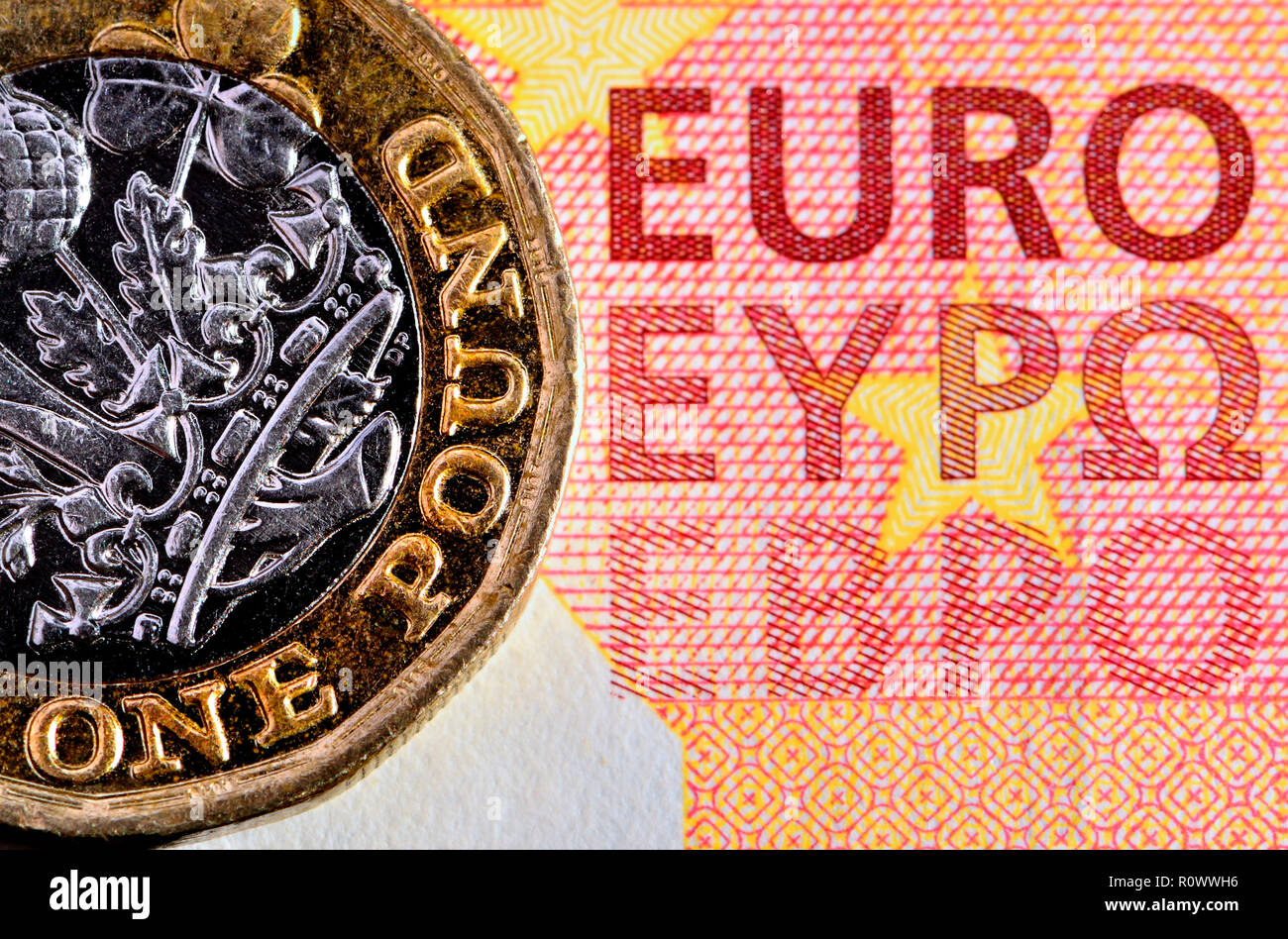 British £1 coin on a 10 Euro note Stock Photo