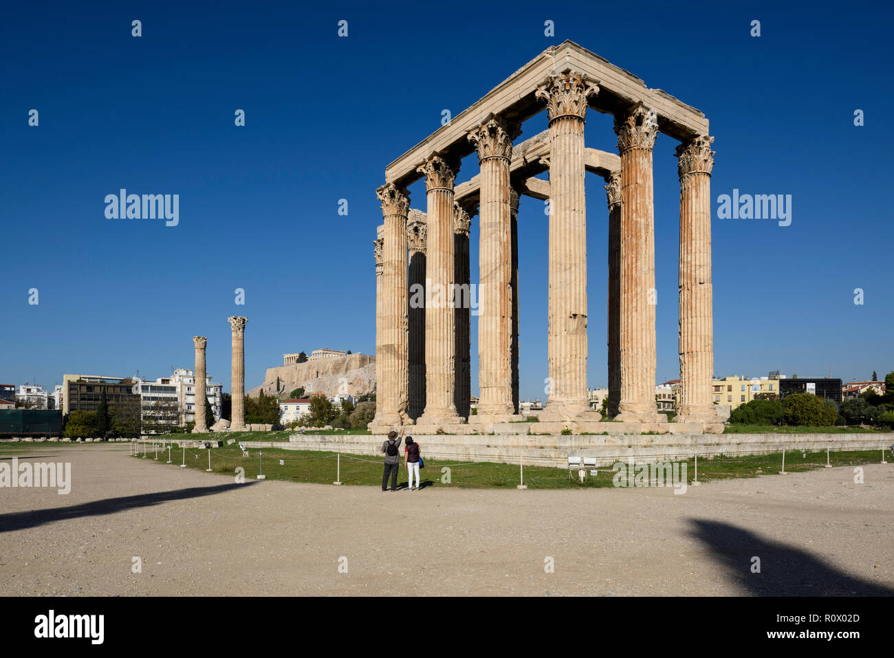 Athens. Greece. The Temple of Olympian Zeus (Olympieion) and the Acropolis in the background. - Stock Image