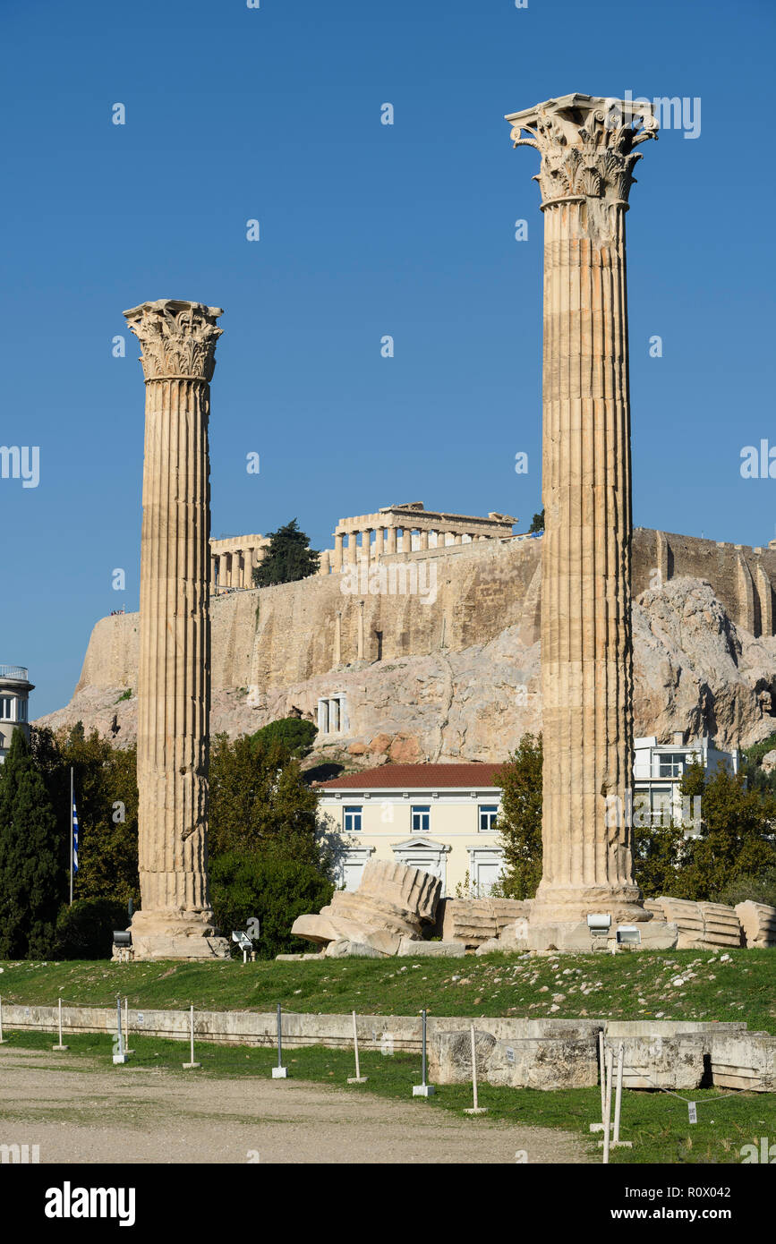 Athens. Greece. Corinthian columns of the Temple of Olympian Zeus (Olympieion) with the Parthenon and Acropolis in the background. - Stock Image