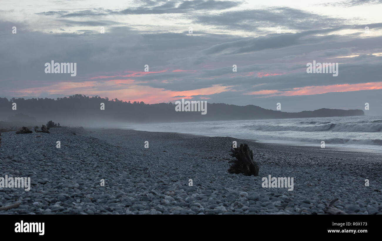 Sunset at Gillespie Beach New Zealand - Stock Image