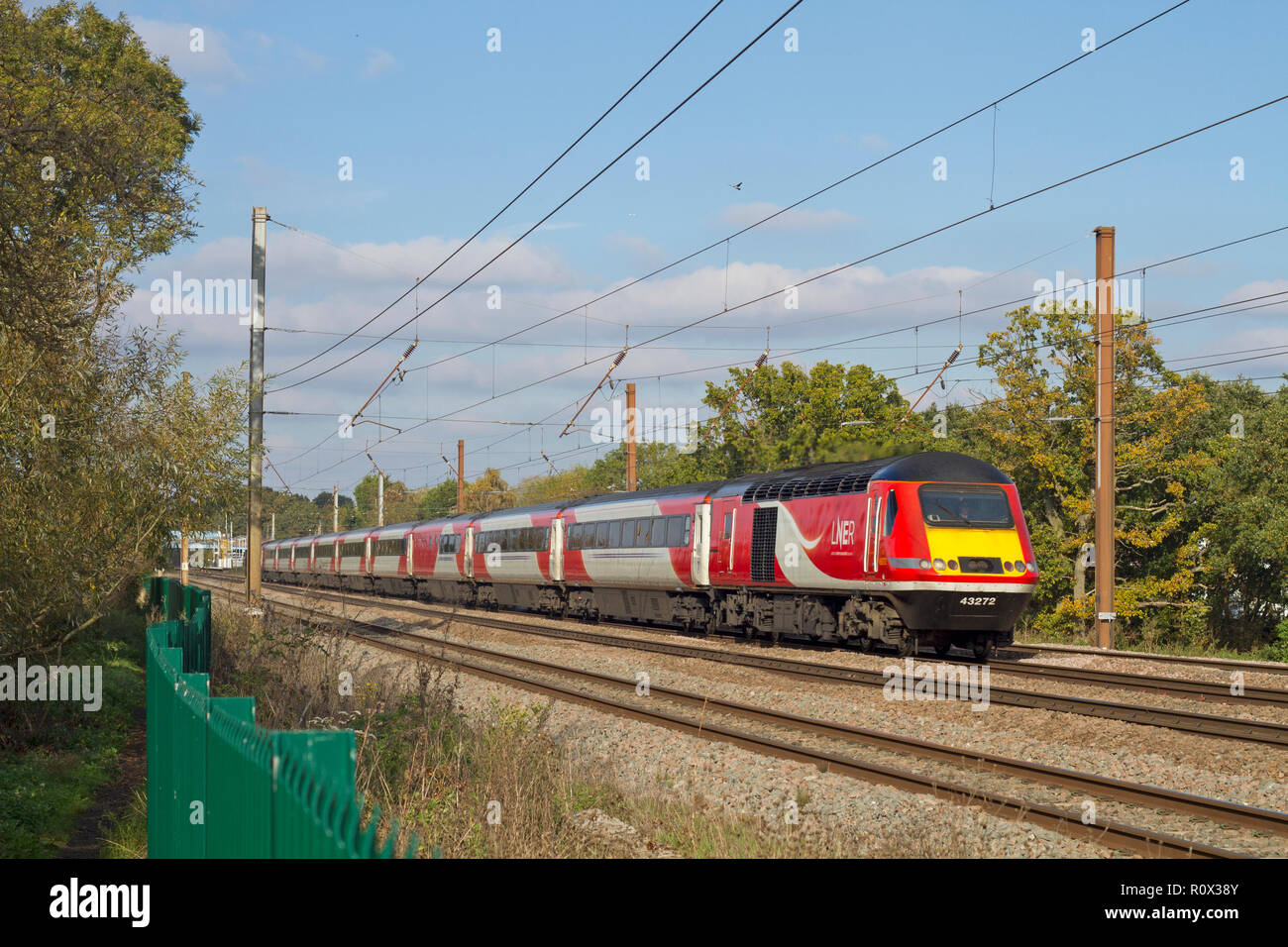 An LNER HST with power cars 43272 and 43306 heads south along the East Coast Mainline at Brookmans Park. - Stock Image