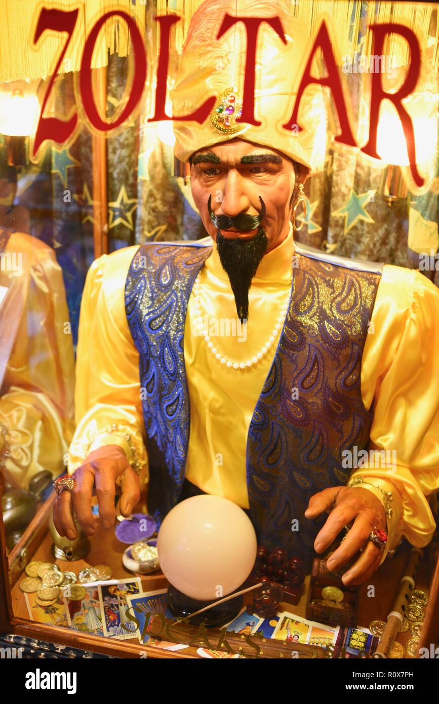 """Close-up of animatronic fortune-telling machine, after receiving payment, makes a prediction """"Zoltar Speaks"""" from Zoltar, by Characters Unlimited. Stock Photo"""