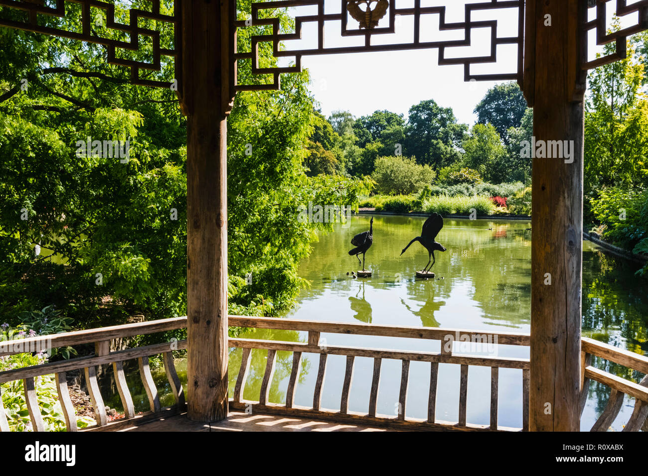 England, Surrey, Guildford, Wisley, The Royal Horticultural Society Garden, Seven Acres Pond and The Japanese Pagoda Stock Photo