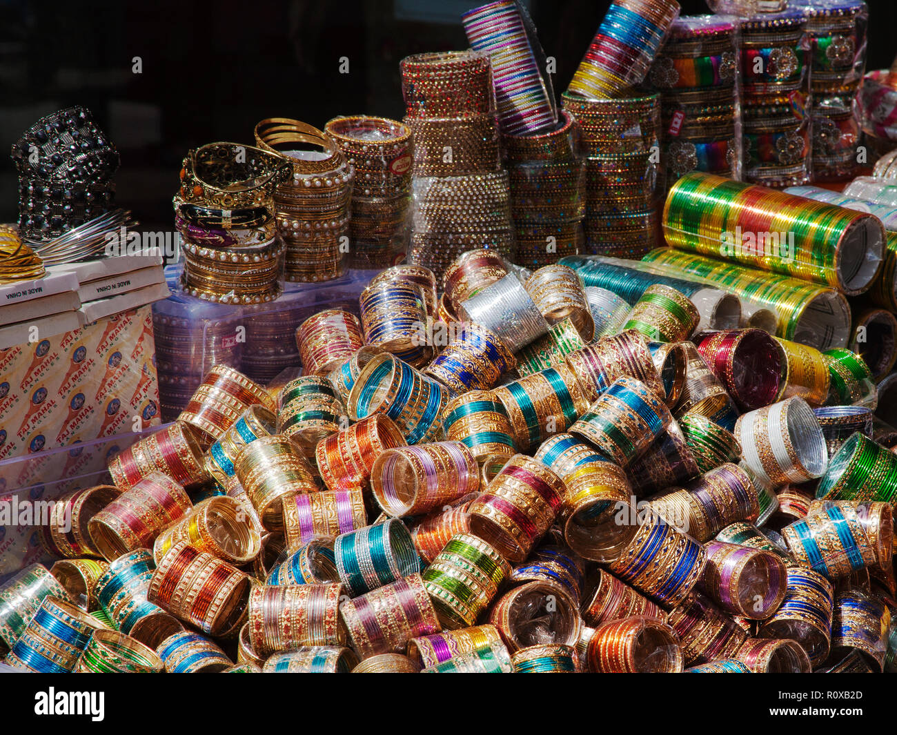 Colorful Indian and Oriental bangles in shop display the broadway southall london 'Little India' - Stock Image
