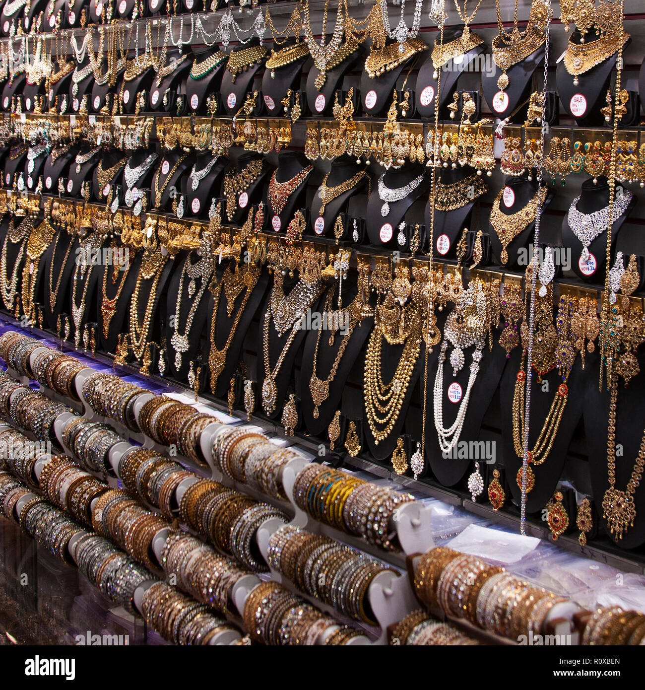 gold and silver jewelry display in shop on the broadway southall little india London adornment, armlets,asian,bracelets,brass,brooches,clasps,collars, - Stock Image