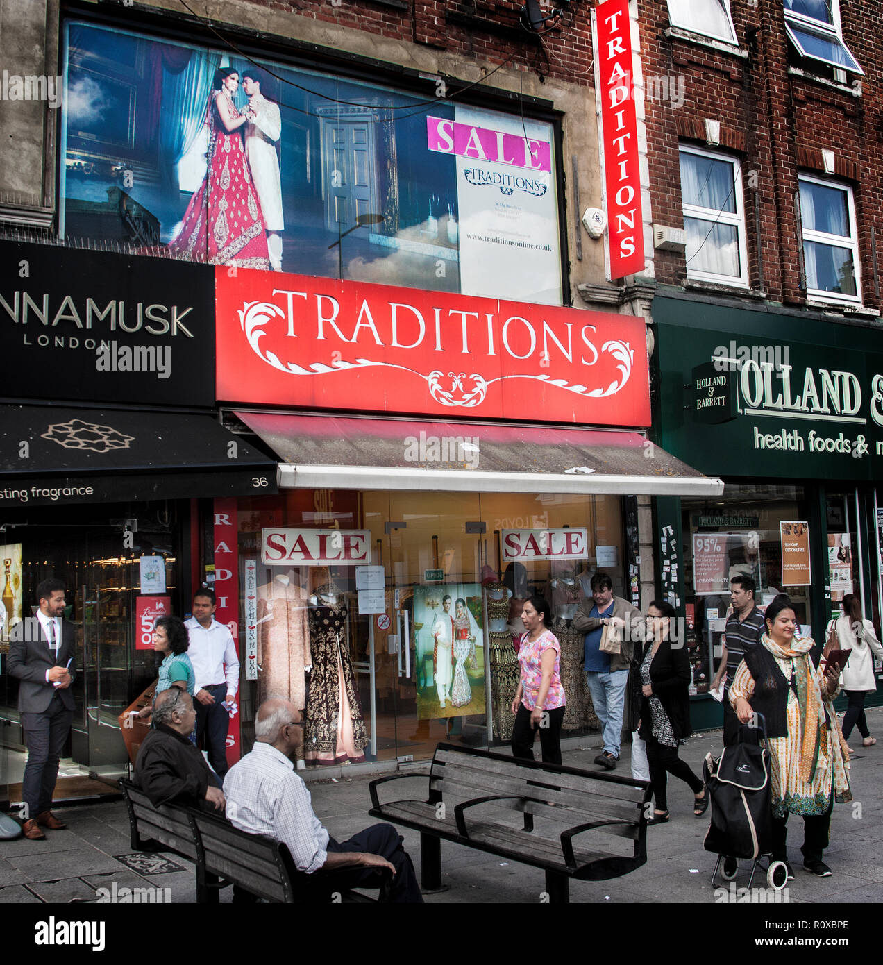 street scene outside Traditions clothes shop,southall broadway London - Stock Image