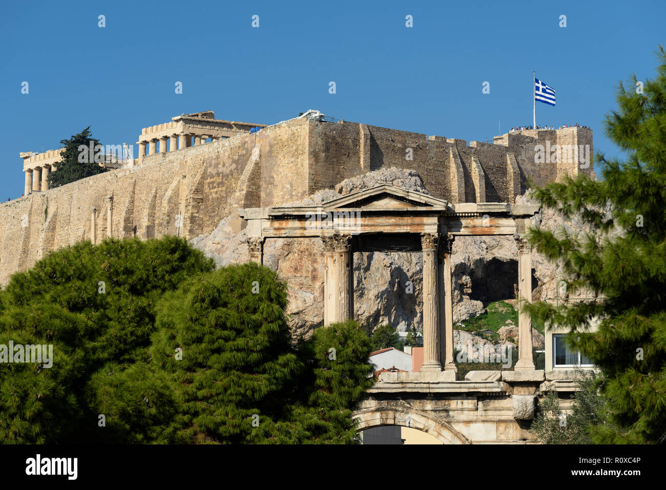 Athens. Greece. Roman Arch of Hadrian aka Hadrian's Gate, with the Parthenon and Acropolis in the background. (pediment of the upper level). - Stock Image