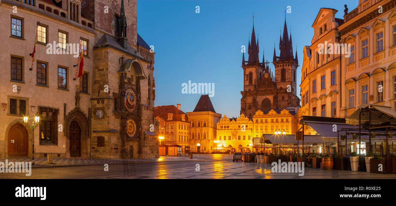 PRAGUE, CZECH REPUBLIC - OCTOBER 16, 2018: The Orloj on the Old Town hall, Staromestske square and Our Lady before Týn church at dusk. - Stock Image