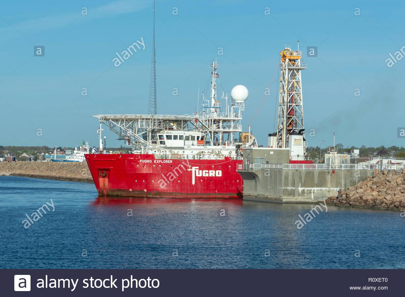 New Bedford, Massachusetts, USA - May 11, 2018: Drilling vessel Fugro Explorer easing through hurricane barrier in New Bedford harbor - Stock Image