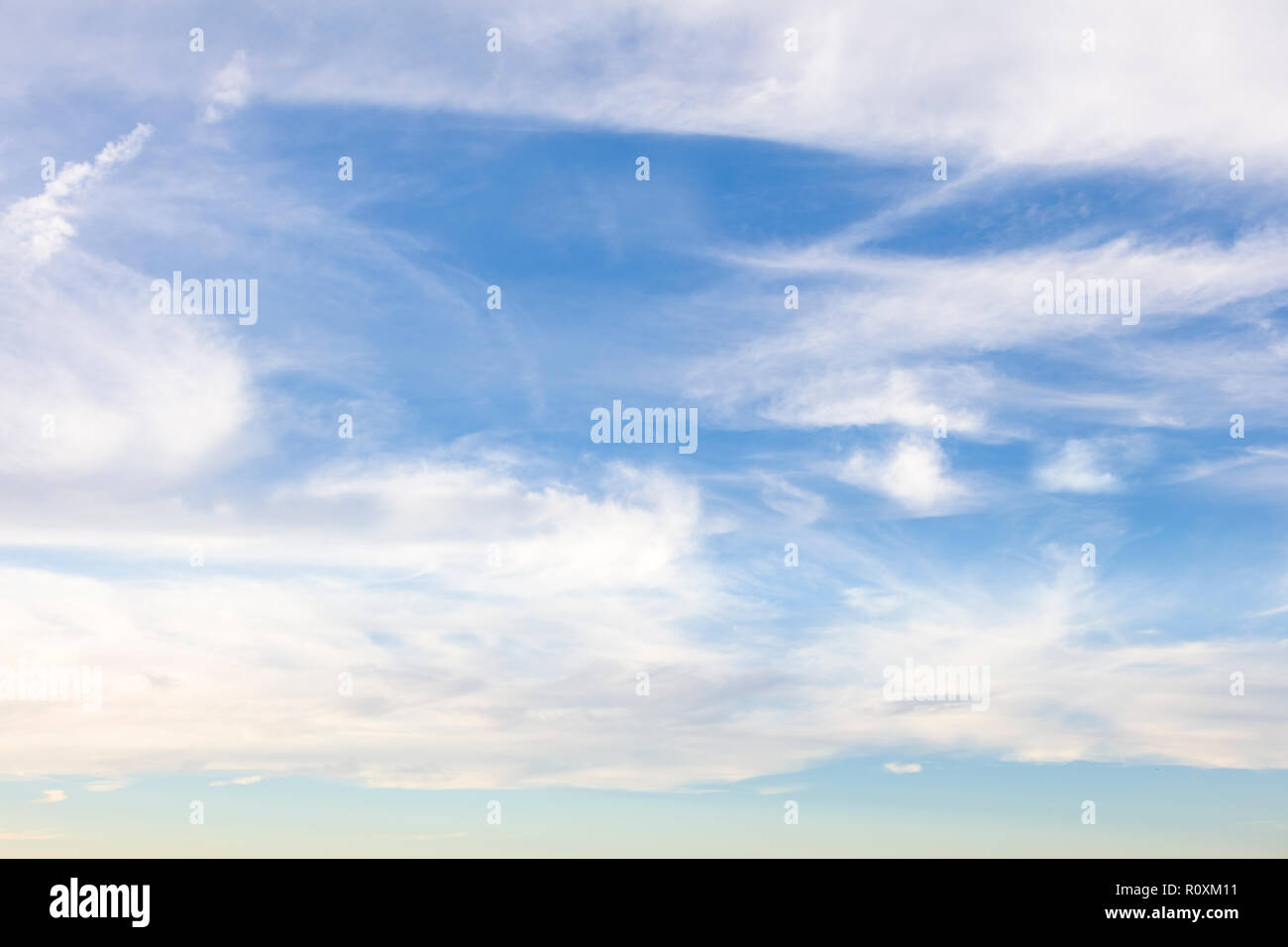 Wispy white clouds in a blue sky over the Gulf of Mexico in southwest Florida, United States - Stock Image