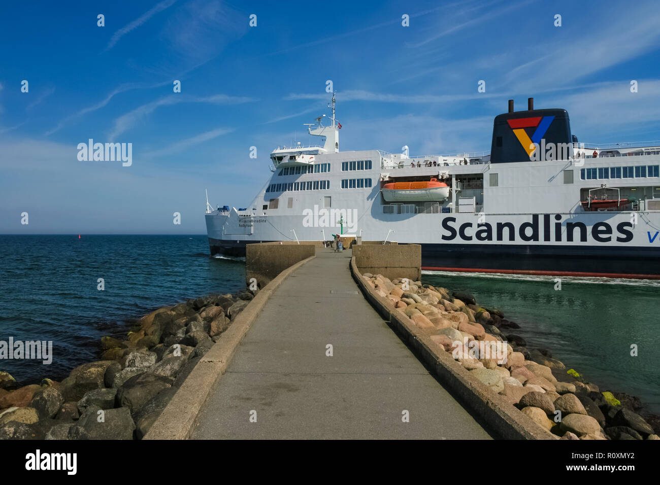 Puttgarden, Fehmarn, Germany - May 6, 2008: Great close-up view of Prinsesse Benedikte, a ferry operated by Scandlines, passing by the breakwaters and... - Stock Image