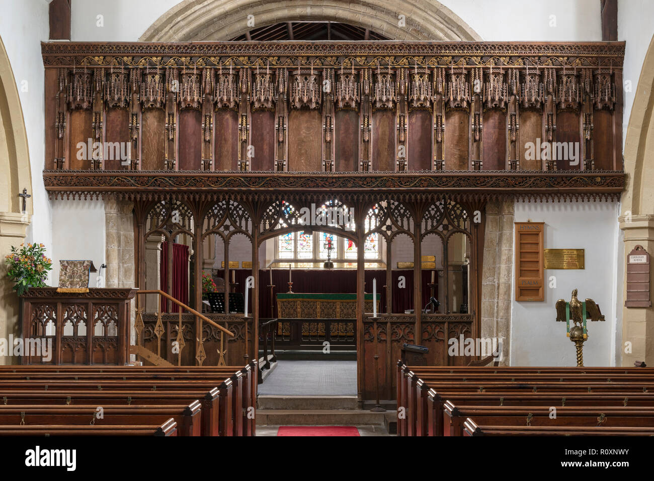 An intricately carved 16th century Rood Screen preserved in St. Oswald's Church, Flamborough, Yorkshire, UK Stock Photo