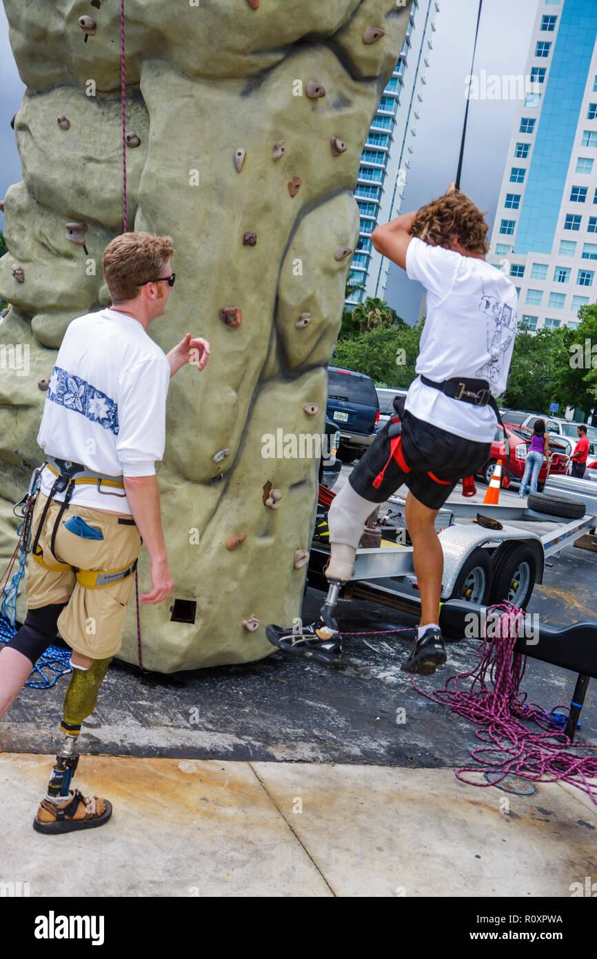Miami Coconut Grove Florida Shake-a-Leg Miami No Barriers Festival disabled physical disability handicapped man rock climbing li - Stock Image