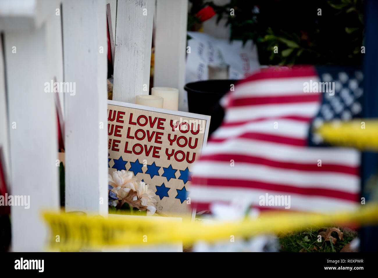 'We love you' placard and an American flag are seen during the midterm elections in Pittsburgh, PA in the aftermath of the Tree of Life shootings. - Stock Image