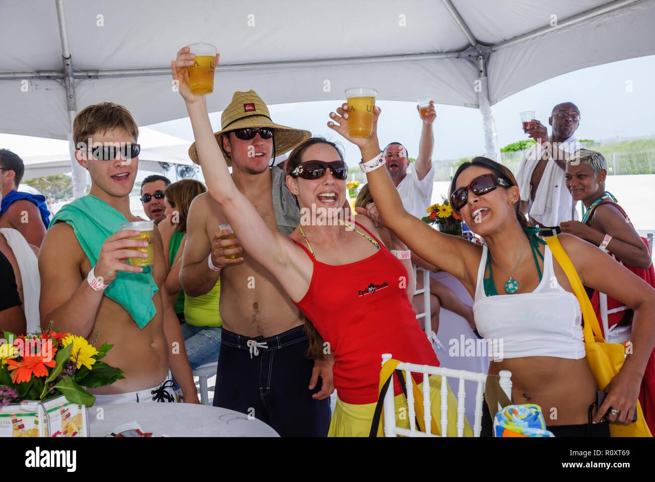 Miami Beach Florida Lummus Park Shape Bikini Body Tour fitness festival fair free Michelob beer Hispanic man woman drinking alco - Stock Image