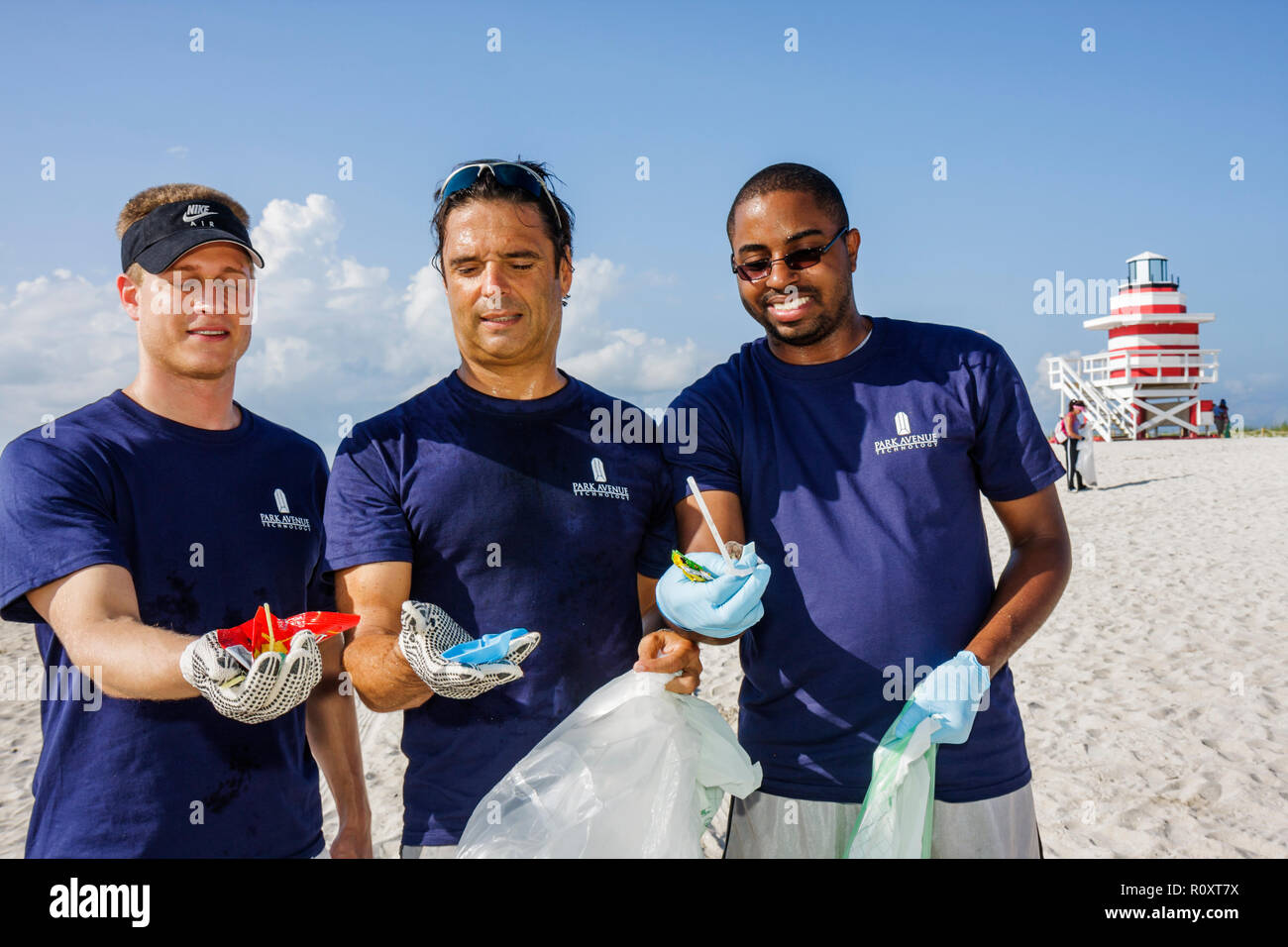 Miami Beach Florida Atlantic Ocean public beach shoreline ECOMB Big Sweep environment volunteer cleanup clean-up clean up litter - Stock Image