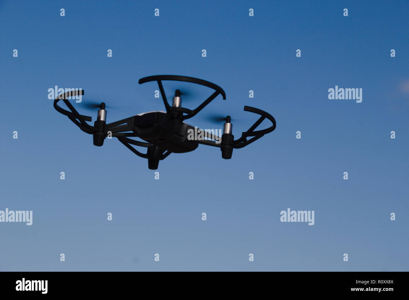 Flying drone howering in the sky - Stock Image