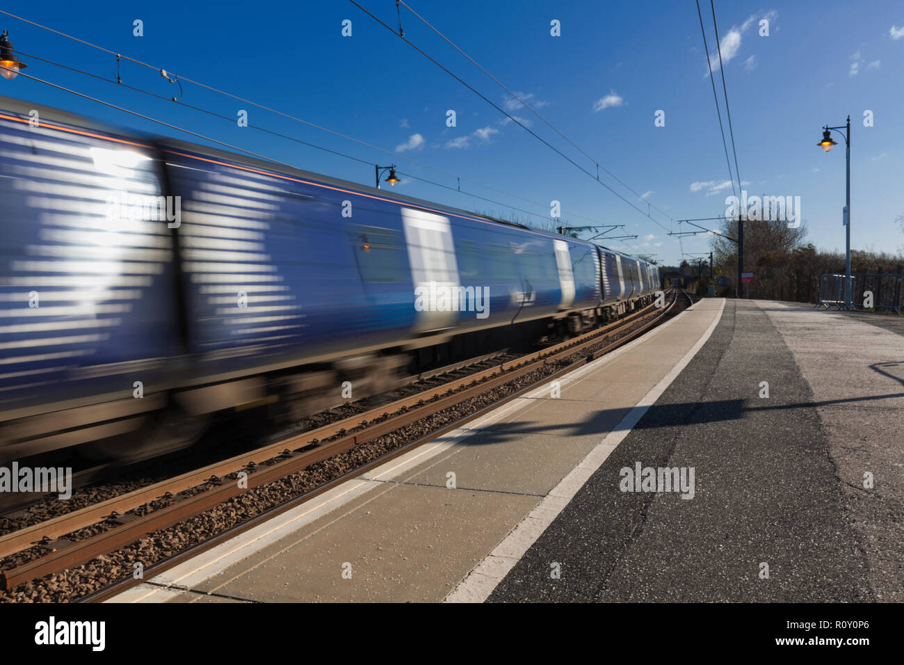 A Scotrail class 380 electric train departing Troon railway station - Stock Image