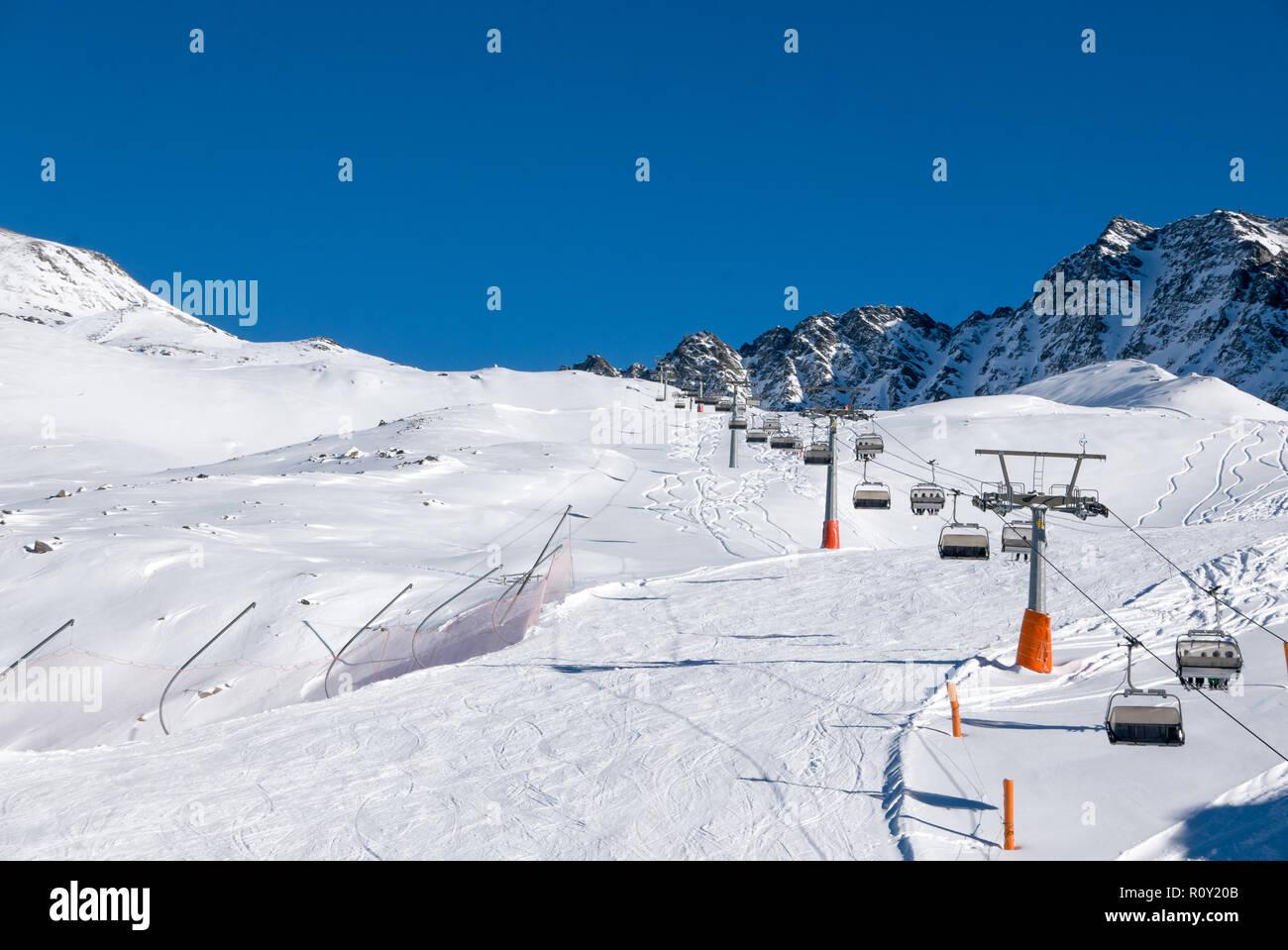 ski holiday, sunny day in popular alpine ski resort, solda (sulden