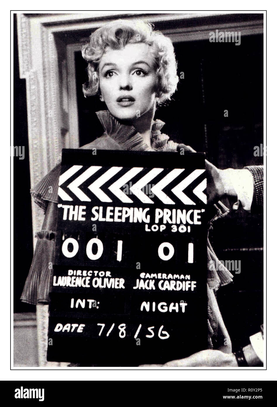 1950's Marilyn Monroe on the set of 'The Sleeping Prince' ( The Prince and The Showgirl) in a screen test with on-set clapper board showing Director Lawrence Olivier & Cameraman Jack Cardiff  7/8/1956 - Stock Image