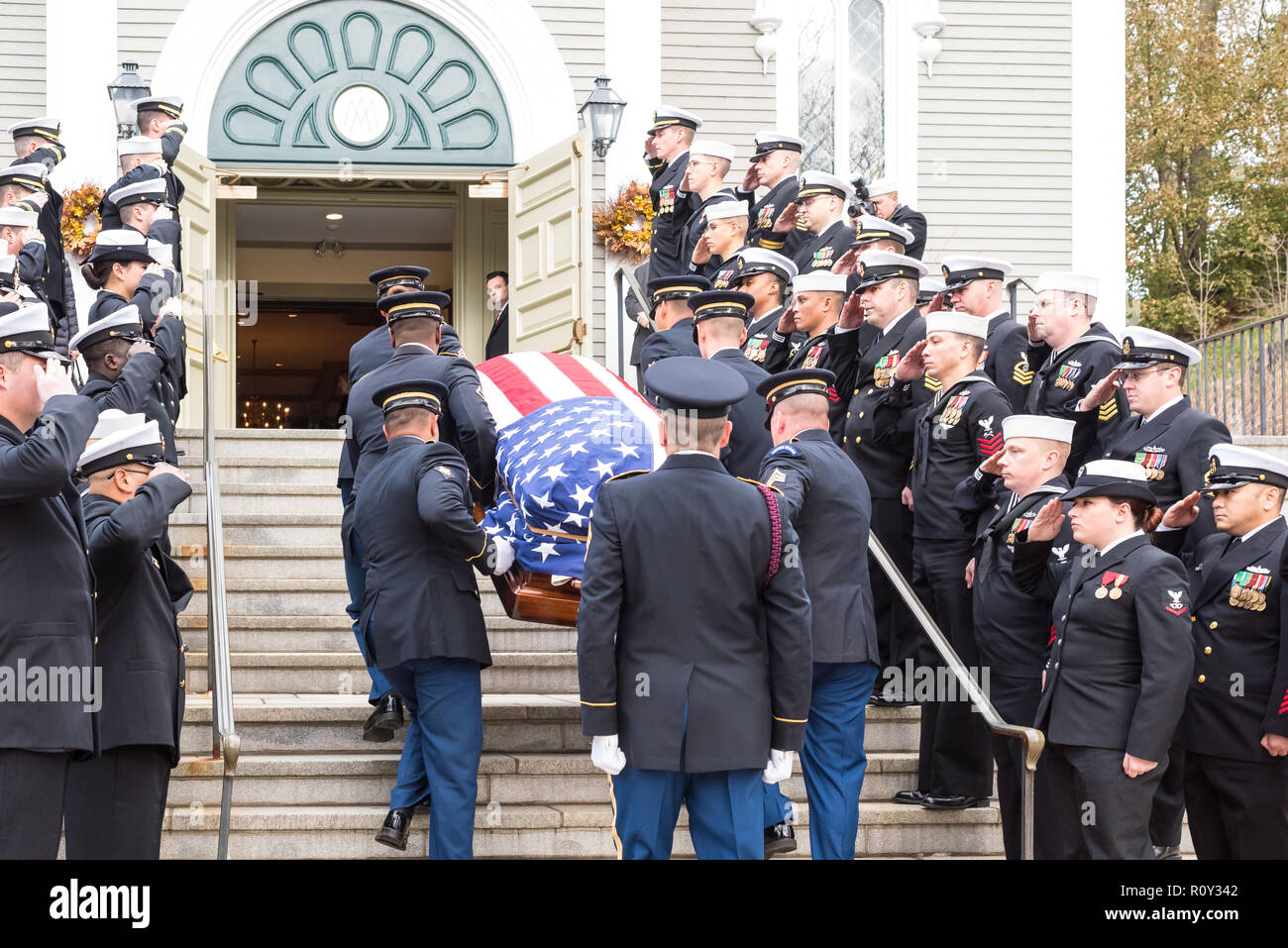 Military Funeral Honors Team of the Massachusetts Army National Guard carries the flag draped casket of Medal of Honor recipient Thomas J. Hudner. - Stock Image
