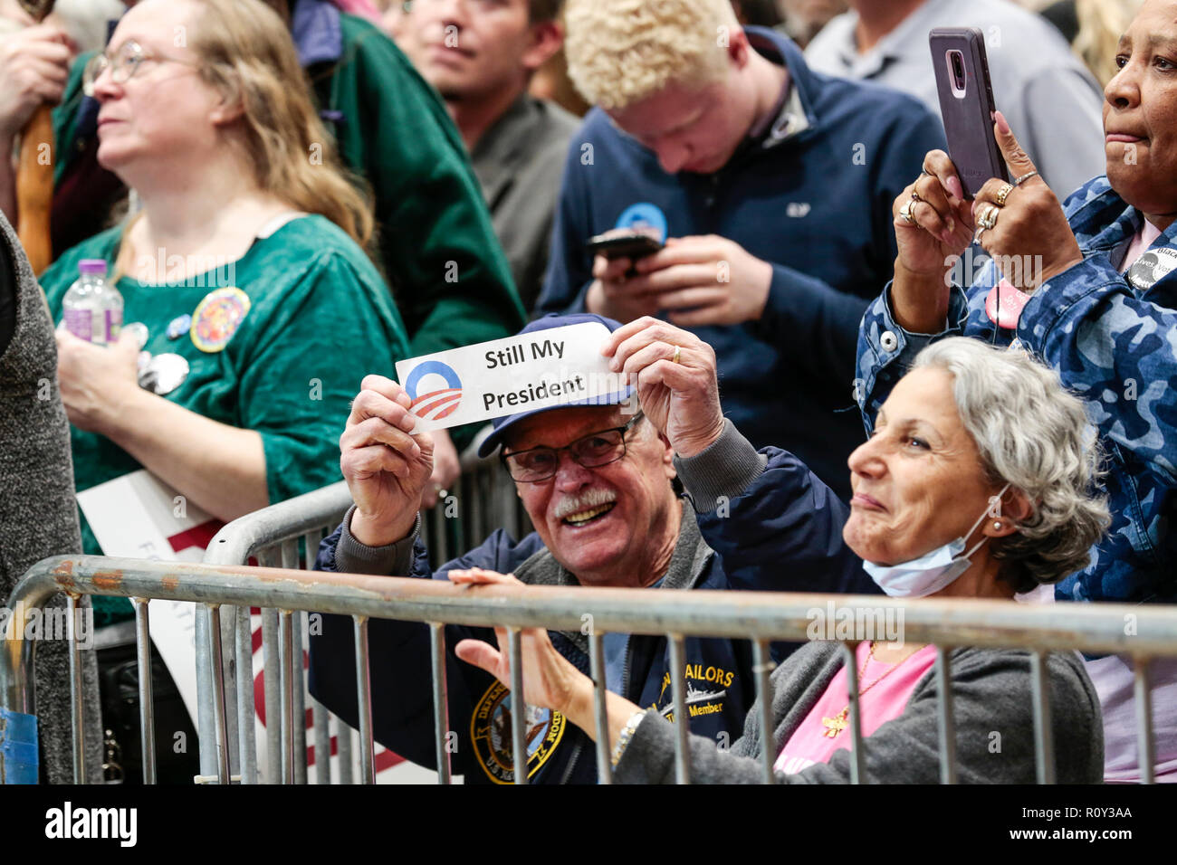 A man holds a 'Still My President' sign in a crowd during a rally that former president Barack Obama speaks at in Milwaukee, Wisconsin. - Stock Image