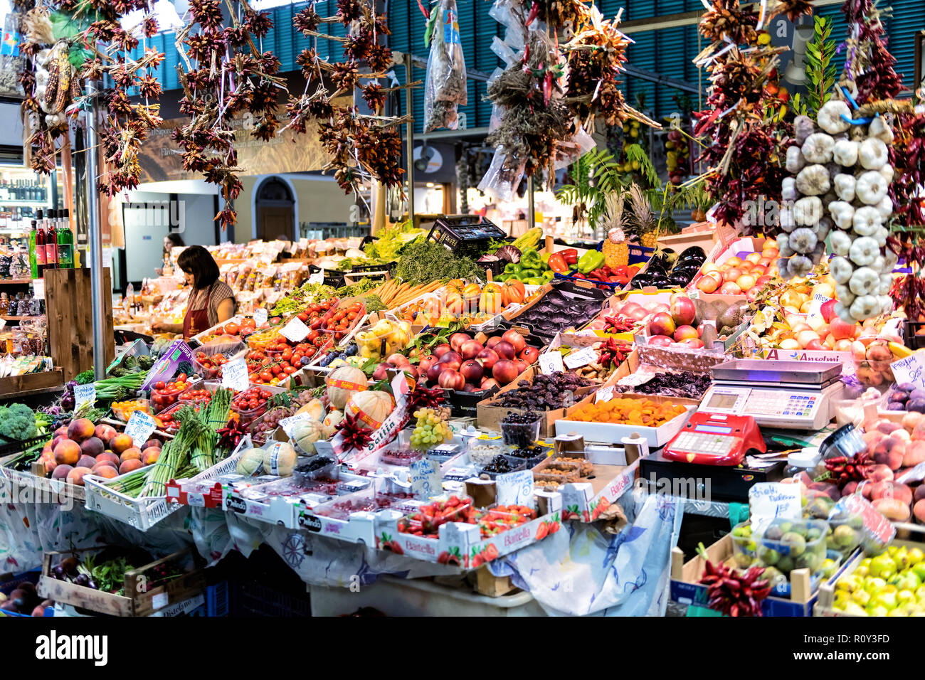 Florence, Italy - August 30, 2018: Firenze mercato centrale, central market with kiosk, stall, stand selling fresh farmers produce, fruit, vegetable o - Stock Image