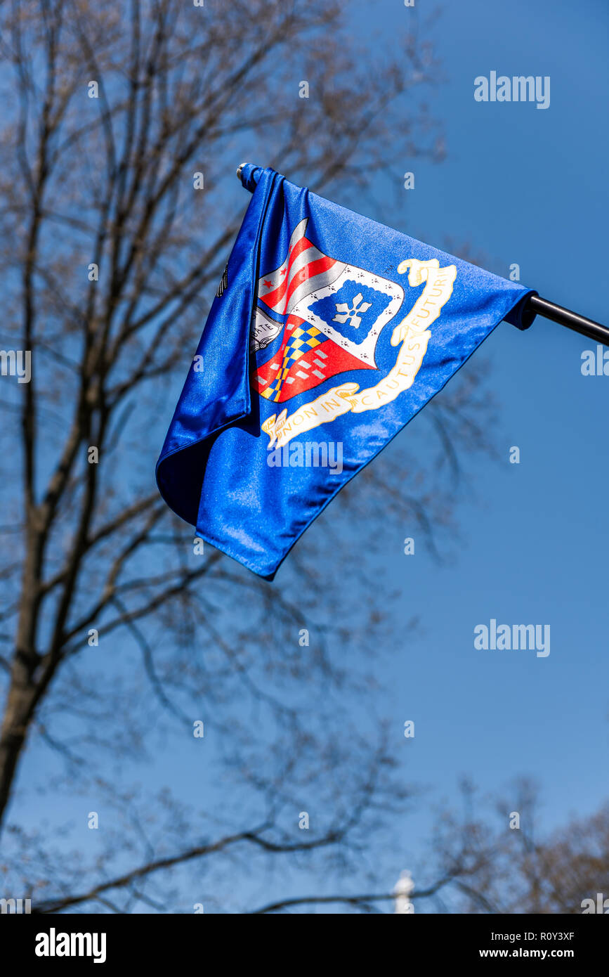Lexington, USA - April 18, 2018: Washington and Lee University flag vertical in Virginia closeup isolated against blue sky with sign motto for Non inc - Stock Image