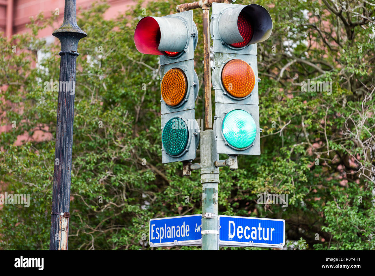 New Orleans, USA Esplanade avenue, Decatur street intersection sign in Louisiana town, city, colorful blue color, nobody, Marigny neighborhood, traffi - Stock Image