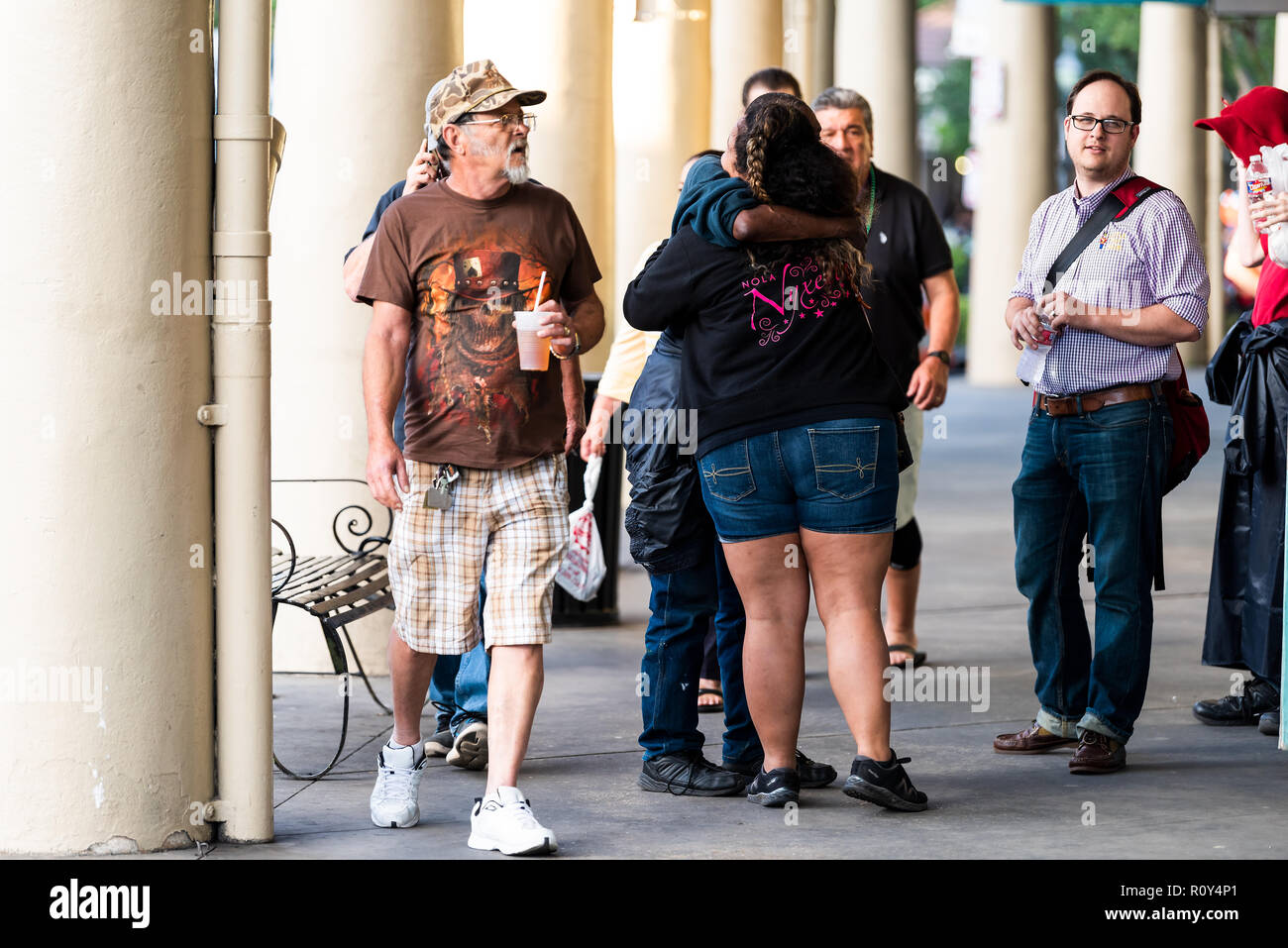 New Orleans, USA - April 22, 2018: Old town Decatur street in Louisiana famous city, people standing hugging, embracing - Stock Image
