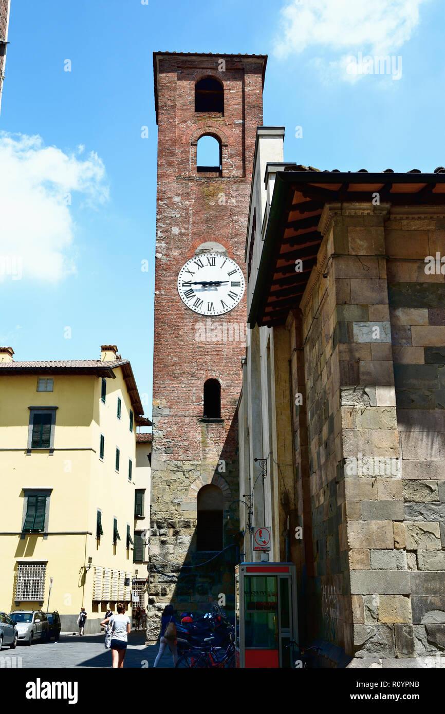 Clock tower in the Mercato del Carmine former chiesa di Santa Maria del Carmine. Lucca, Province of Lucca, Tuscany, Italy, Europe - Stock Image