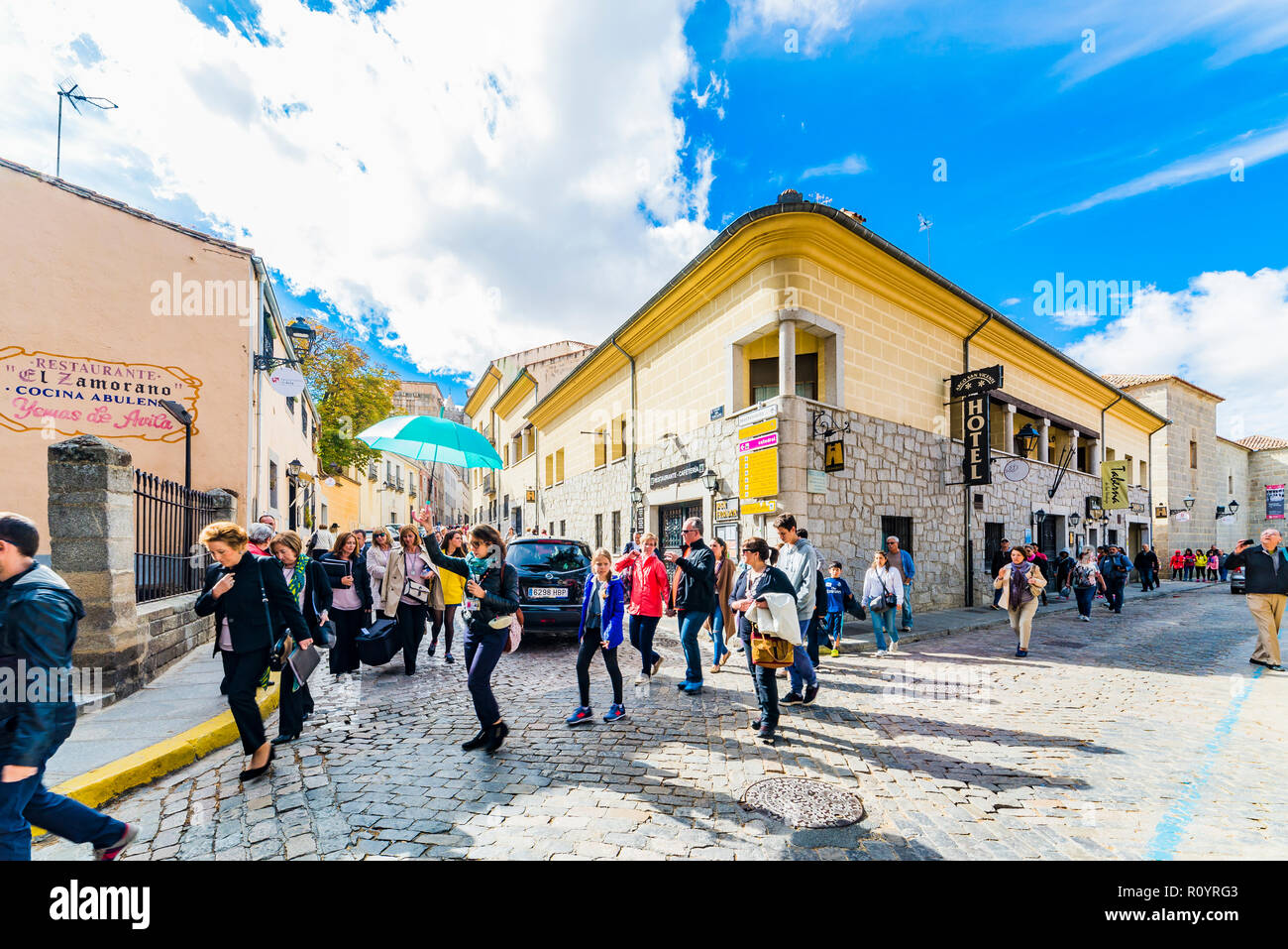 Group of tourists guided in their visit to the historic center. Avila, Castilla y Leon, Spain, Europe - Stock Image
