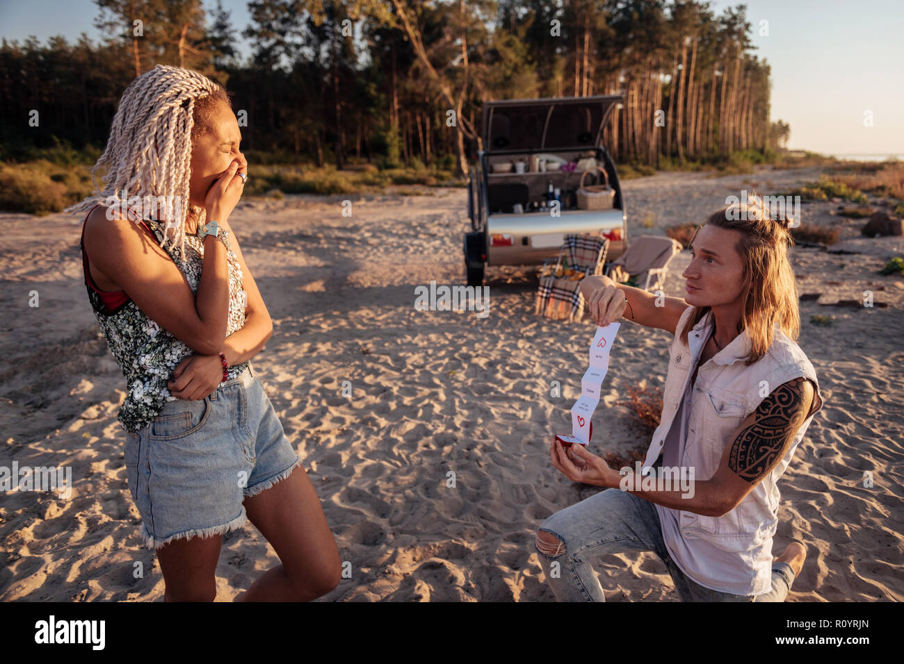 Woman with dreadlocks feeling sentimental listening to love confession Stock Photo