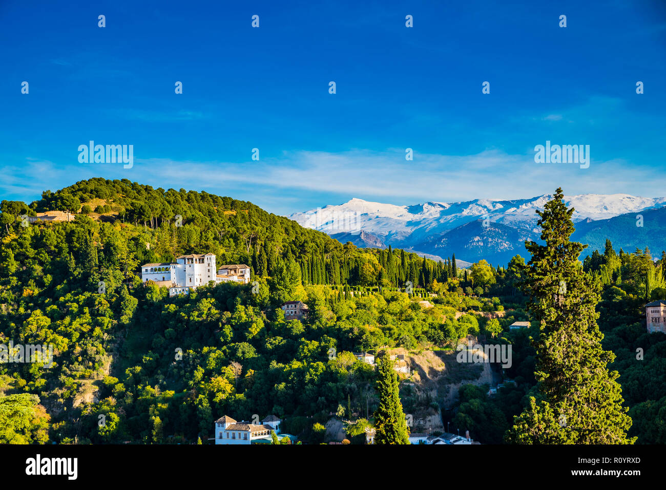 Alhambra. Generalife from Mirador de San Nicolas, in the background Sierra Nevada. Granada, Andalucia, Spain, Europe. - Stock Image