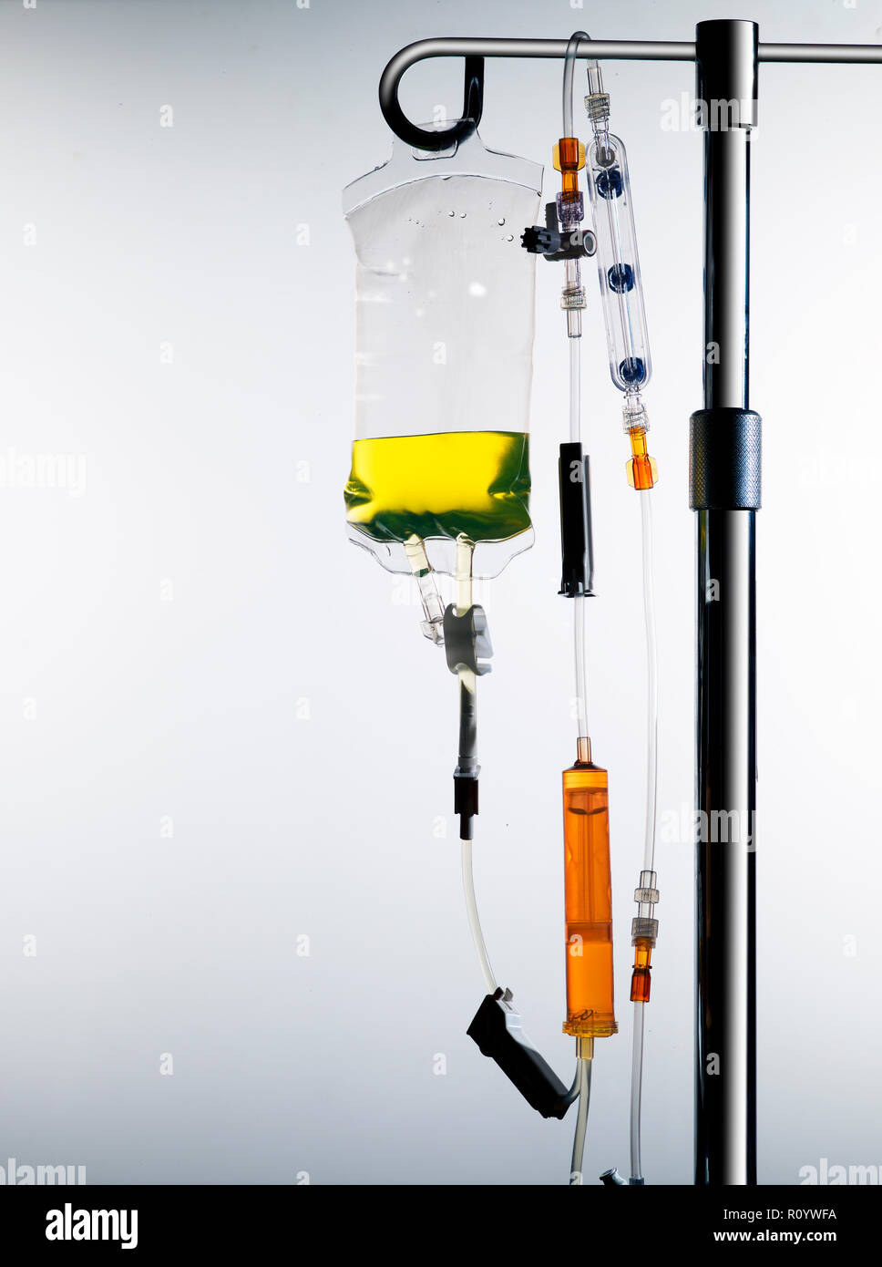 Drip stand with intravenous drug bag and intravenous lines, medical equipment and healthcare treatment Stock Photo