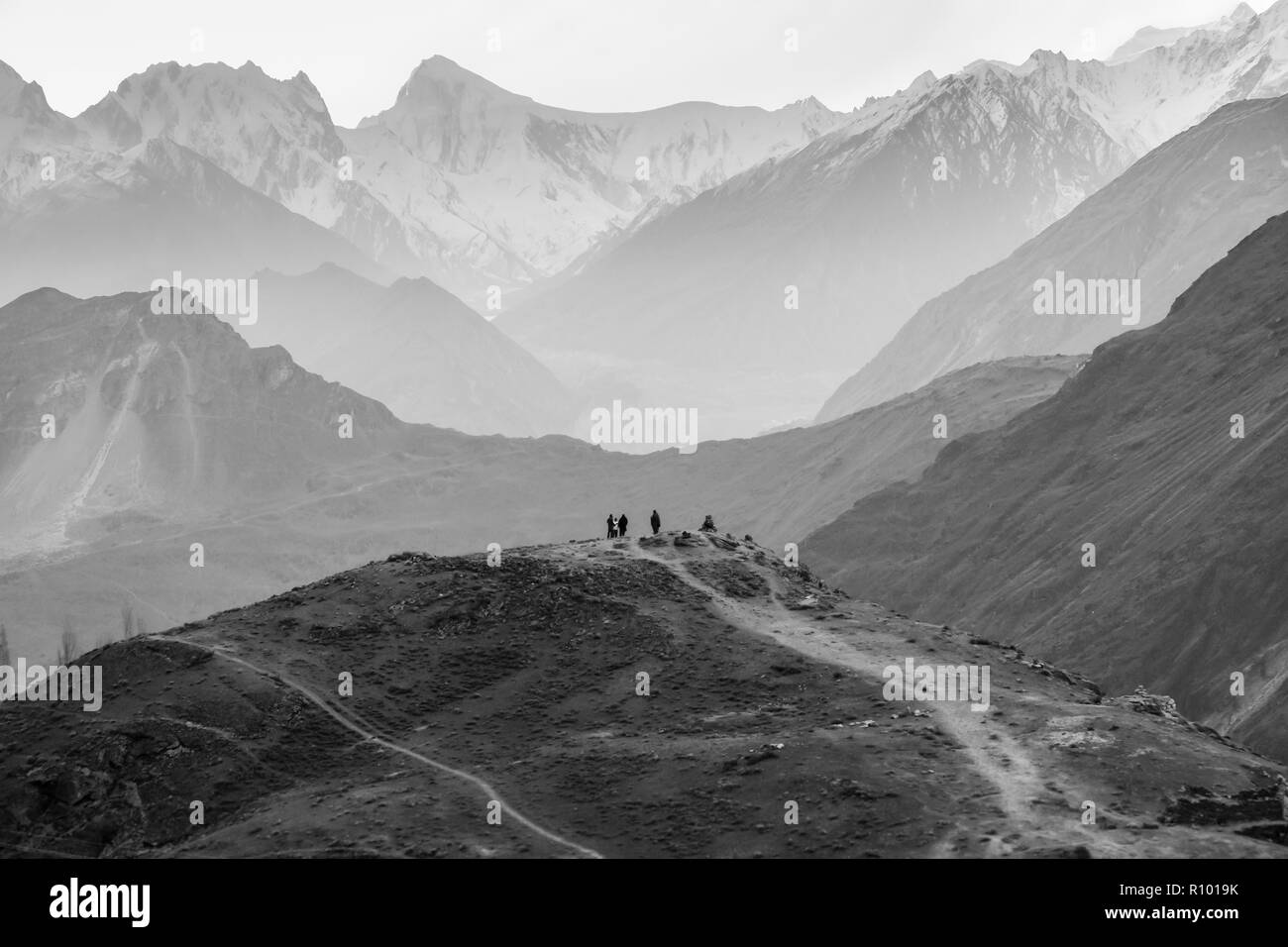 People standing on a hill waiting for rising sun at Hunza valley. Pakistan. - Stock Image