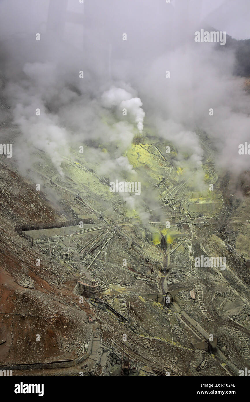 steam and smoke from sulpher vents at owakudani seen from the hakone ropeway japan - Stock Image