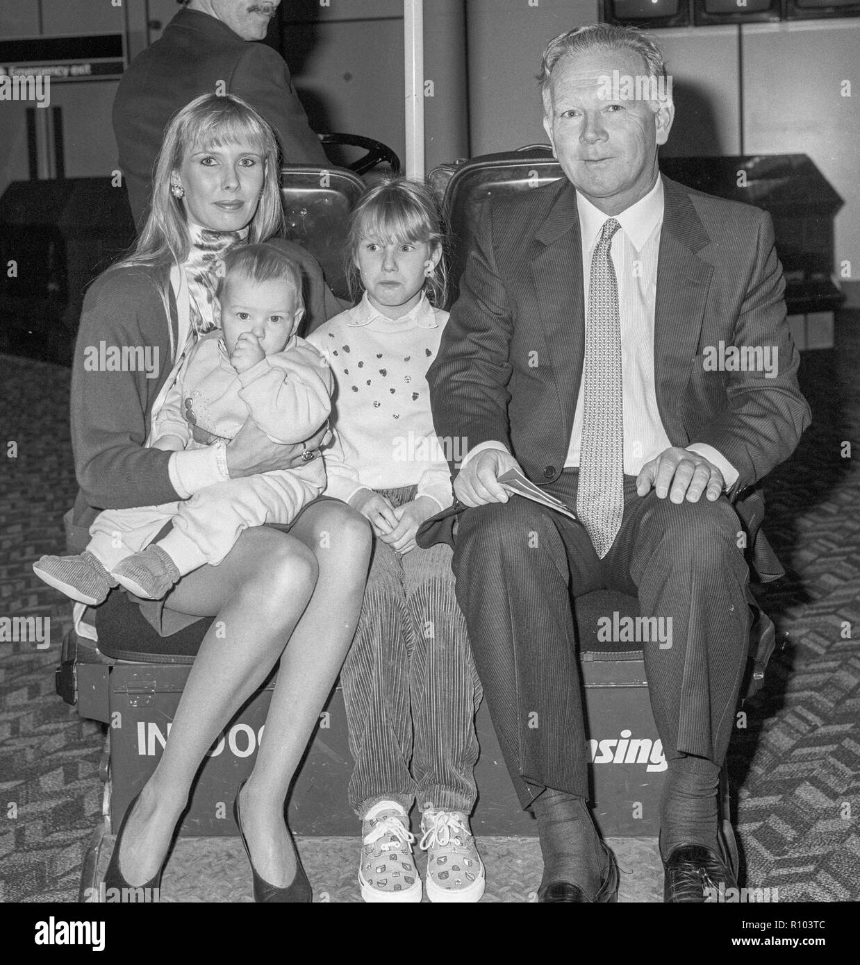 Racehorse owner and breeder Robert Sangster with wife Susan Lilley and two children  leaving Heathrow in February 1988 Stock Photo