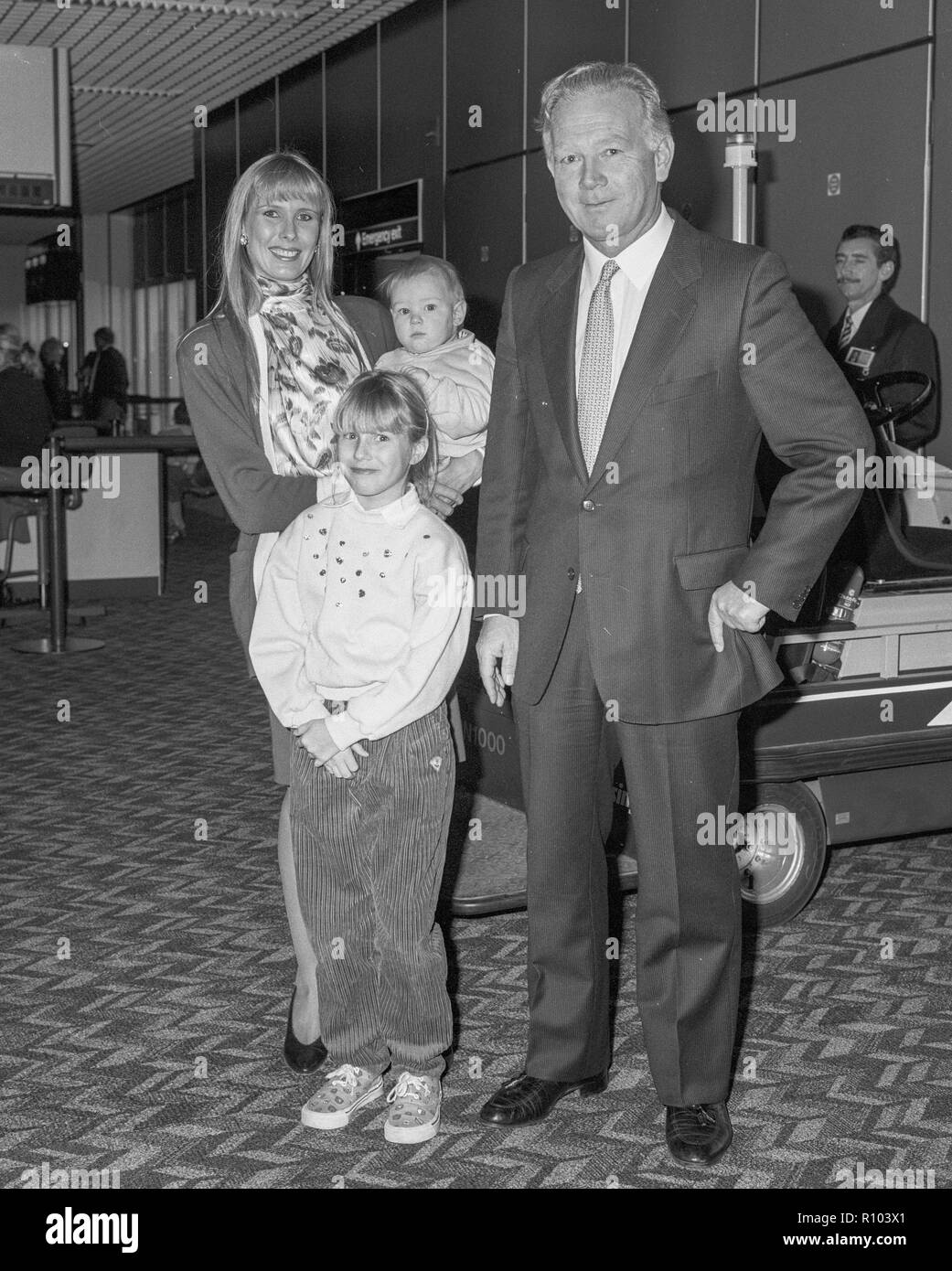 Racehorse owner and breeder Robert Sangster with wife Susan Lilley and two children  leaving Heathrow in February 1988 - Stock Image