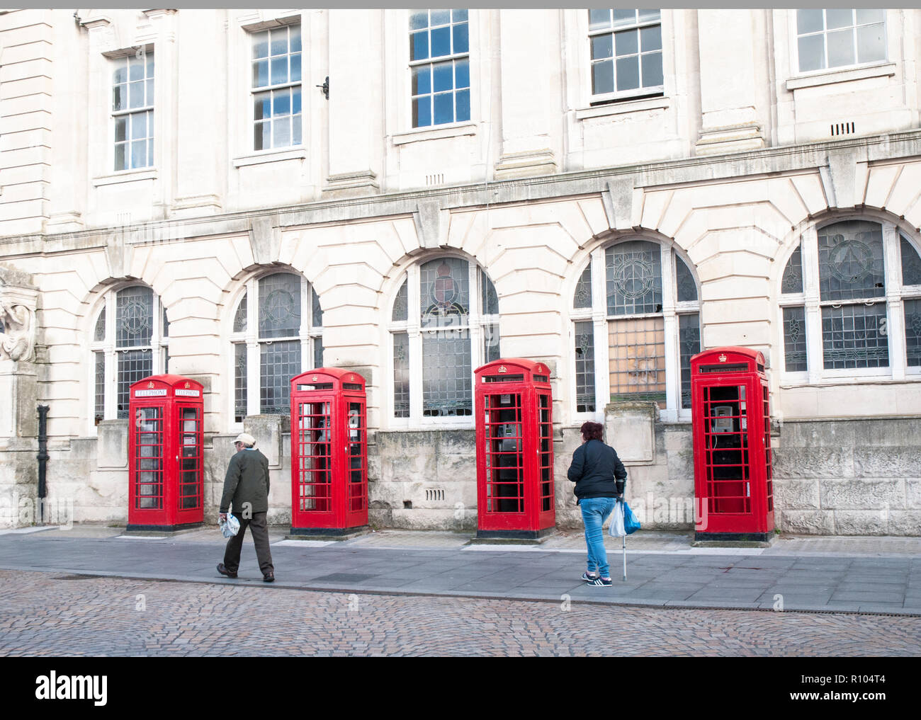 Row of four old style K2 phone boxes outside old General Post Office and Sorting office building in Abingdon street Blackpool Lancashire England UK - Stock Image